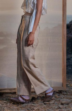 Tea dyed Eri silk pleated trousers with broad turn-up hem.
